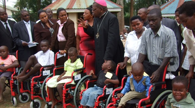 Giving of Wheel Chairs at the official opening ceremony of the Foundation
